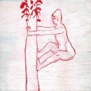 Figur klettert an einer Palme hoch, in rot und weiß